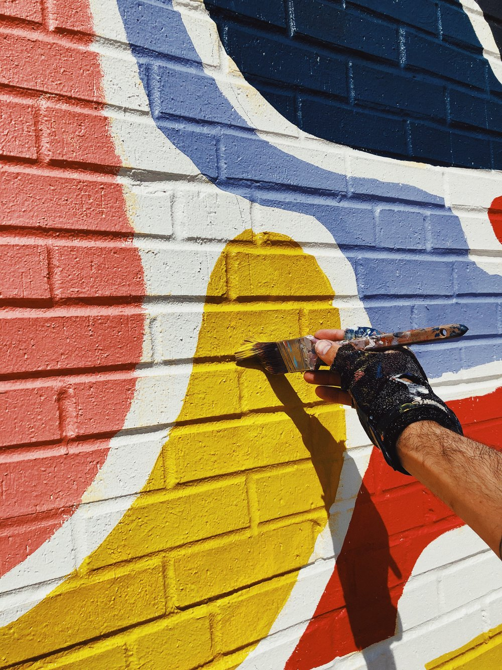 Kyle Steed painting mural at Firehouse.GP in Grand Prairie, TX