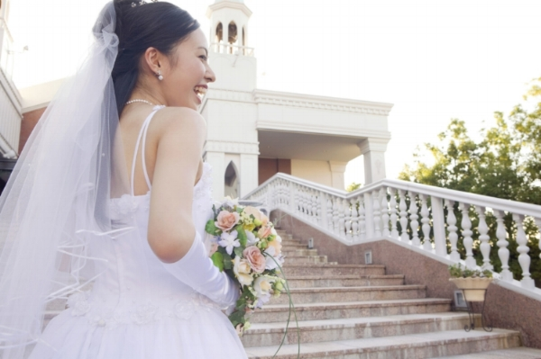 43662877 - rear view of the bride standing on stairs