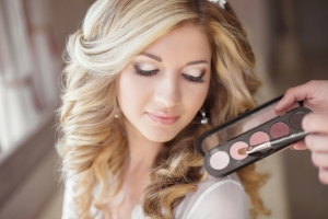 46144411 - beautiful bride wedding with makeup and curly hairstyle. stylist makes make-up bride on wedding day. beauty portrait of young woman at morning.