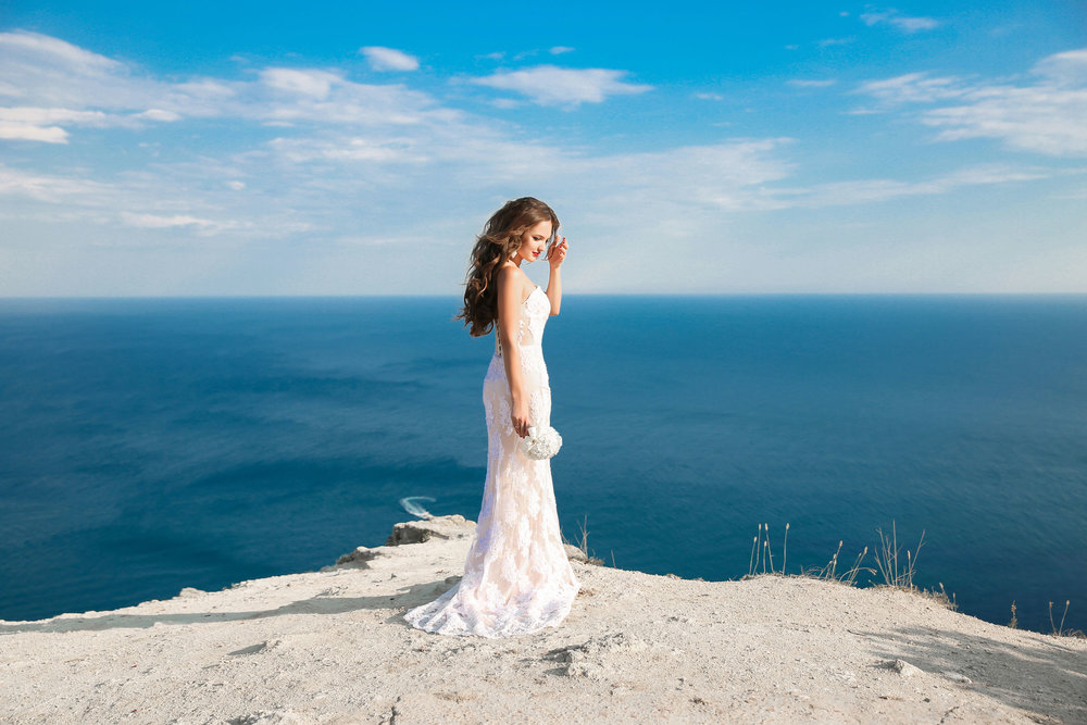 63777060 - beautiful bride in wedding dress outdoors photo. landscape background.