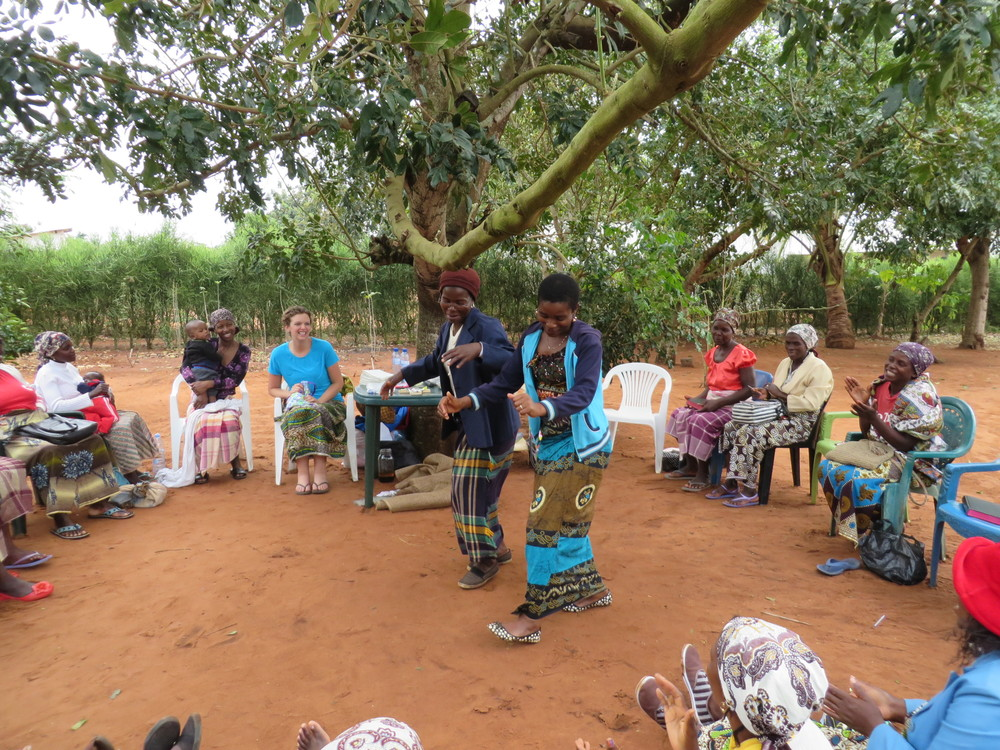 Jenn Lewis (blue shirt) and the women of Mozambique celebrate with dancing and song for the gift of hygiene kits.