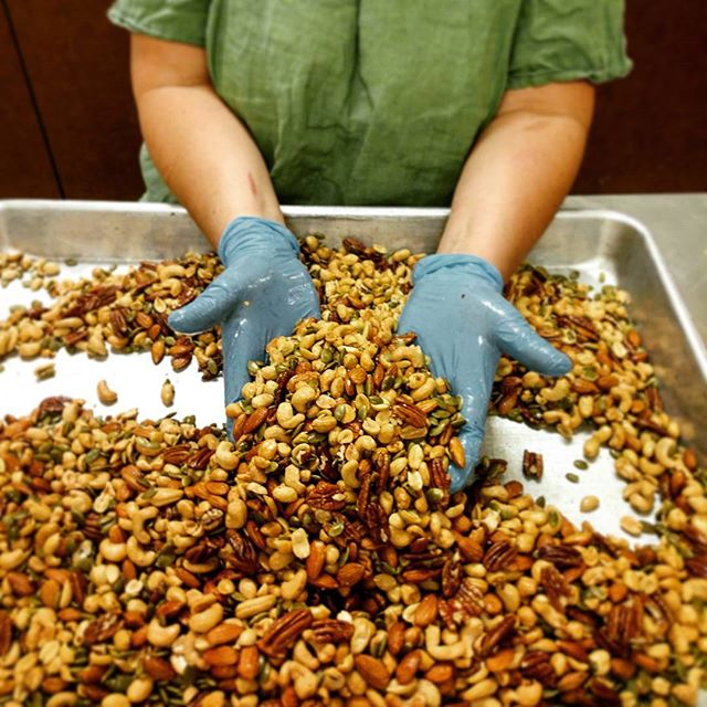Laurie likes to get handsy with our tasty nuts to ensure consistency and perfection #deluxenutmix #someofmybestfriendsarenuts #edibles #portland #potland #marijuana
