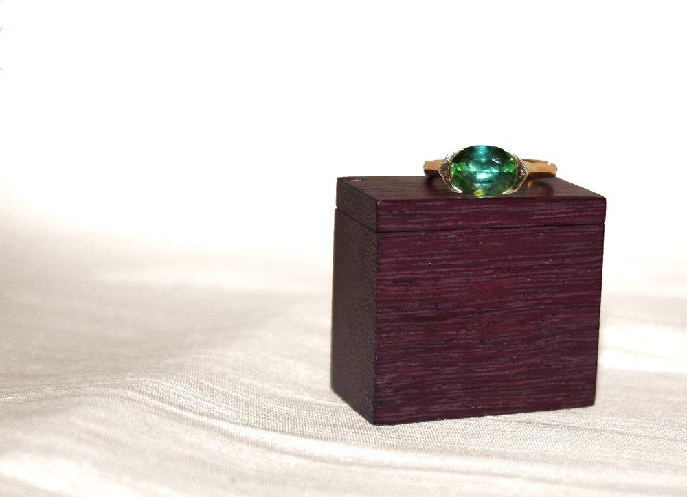 PURPLEHEART RING BOX, 2011. Purpleheart felt, magnet, silver rivet.