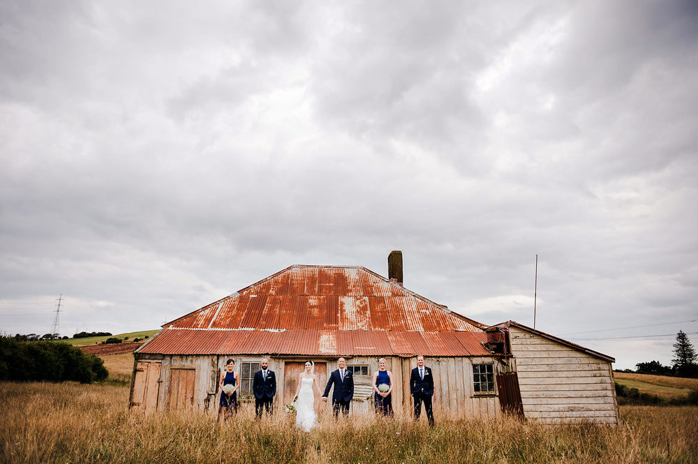 Bridal Party in front of rustic house.jpg