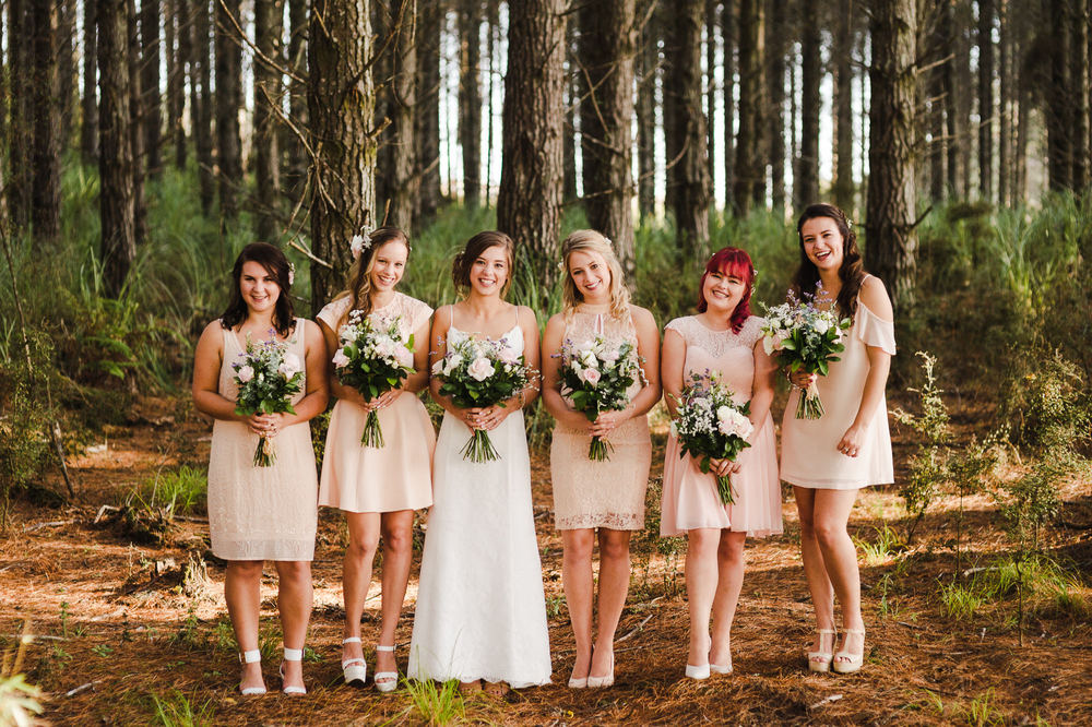 bridesmaids in pastel dresses.jpg