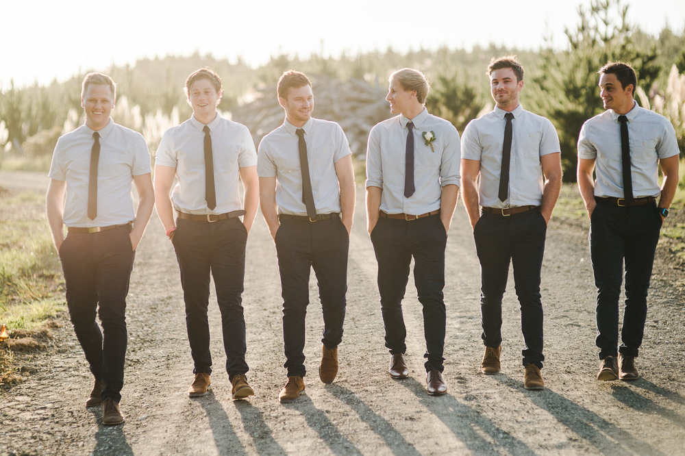 groomsmen in chinos walking.jpg