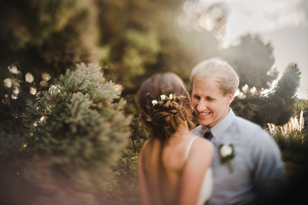 freelensing wedding laughing groom flowers in brides hair.jpg