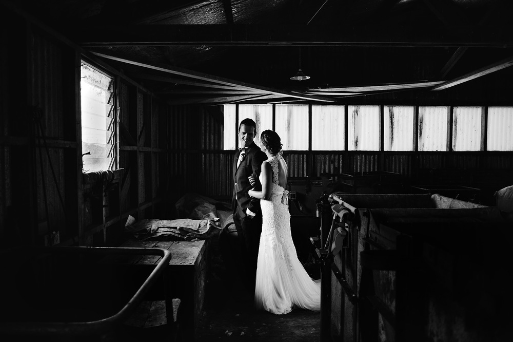 32 Bride and groom in a shearing shed moody black and white hahei wedding.JPG