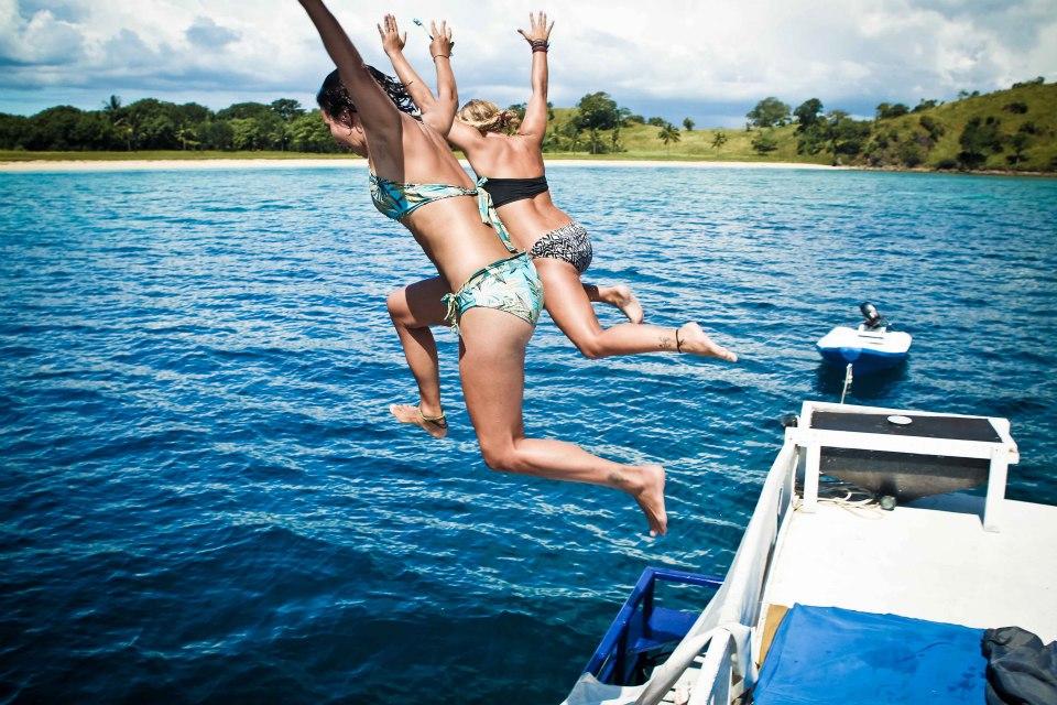 Girls jumoing off roof.jpg