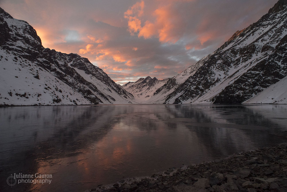 Sunset coming across Laguna del Inca. Especially on cloudier nights there are a few moments of perfect incandescent light, best viewed alone down on the shore.