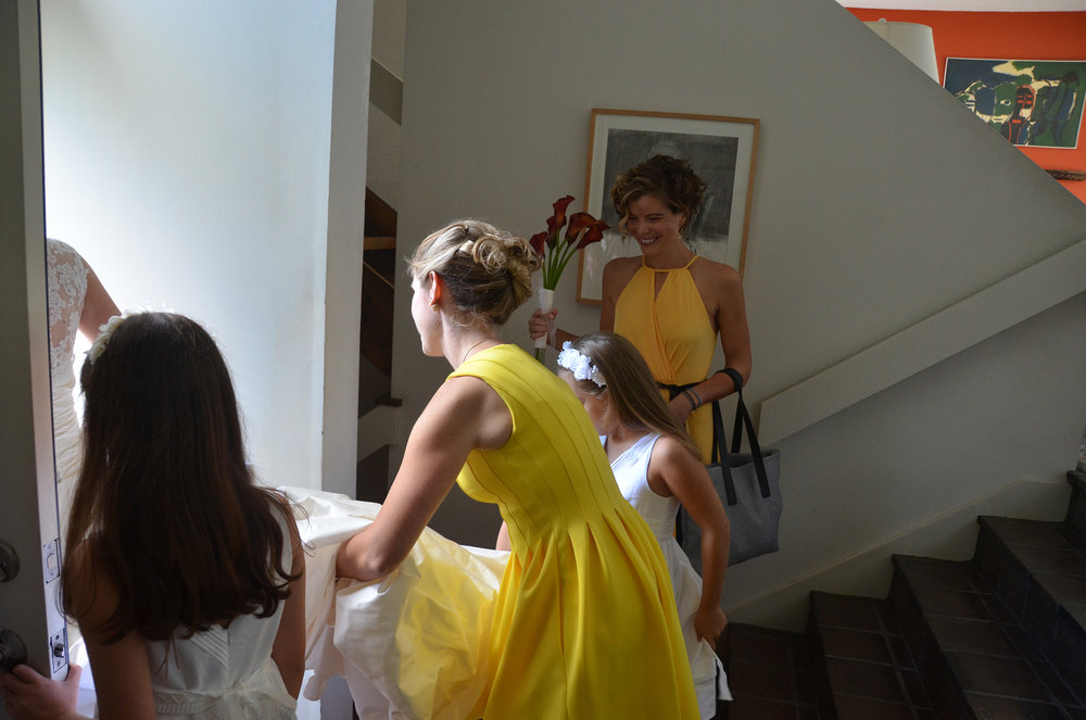 Photograph of us getting Cris out the door, brides maids, casual in color and classic Italian flower girls, taken by the talented Italian photographer,  David Bozzalla .