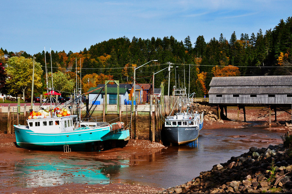 Saint Martin's harbor at low tide, beside their famous covered bridge.