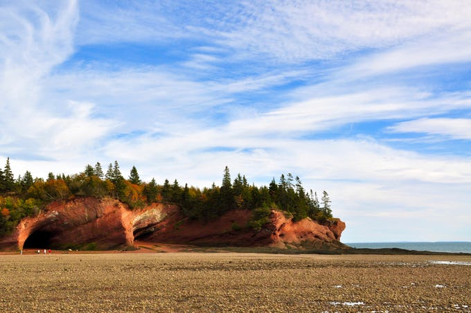 The Sea Caves in Saint Martin are a part of The UNESCO Fundy Biosphere Reserve are worth a visit, as with keep an eye on the tide, for the caves aim for low tide. For scale, the tiny red dots on the left are people.