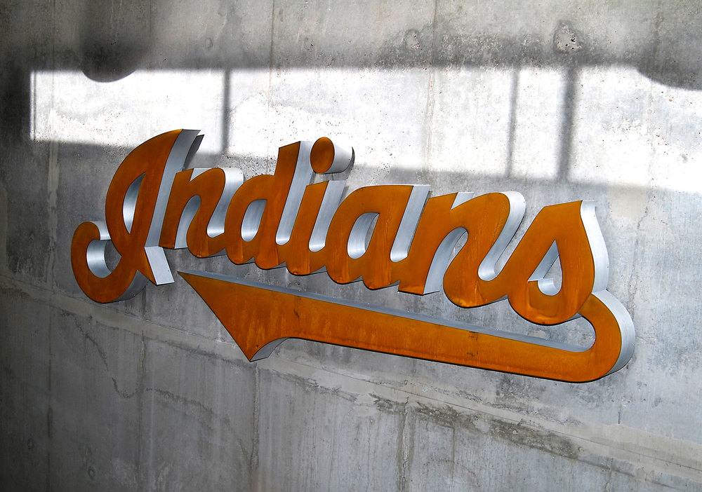 The illuminated Cleveland Indians logo greets players in the development complex lobby. The display is fabricated from waterjet cut Cor-Ten steel with brushed aluminum returns (mounted to a cast concrete wall).