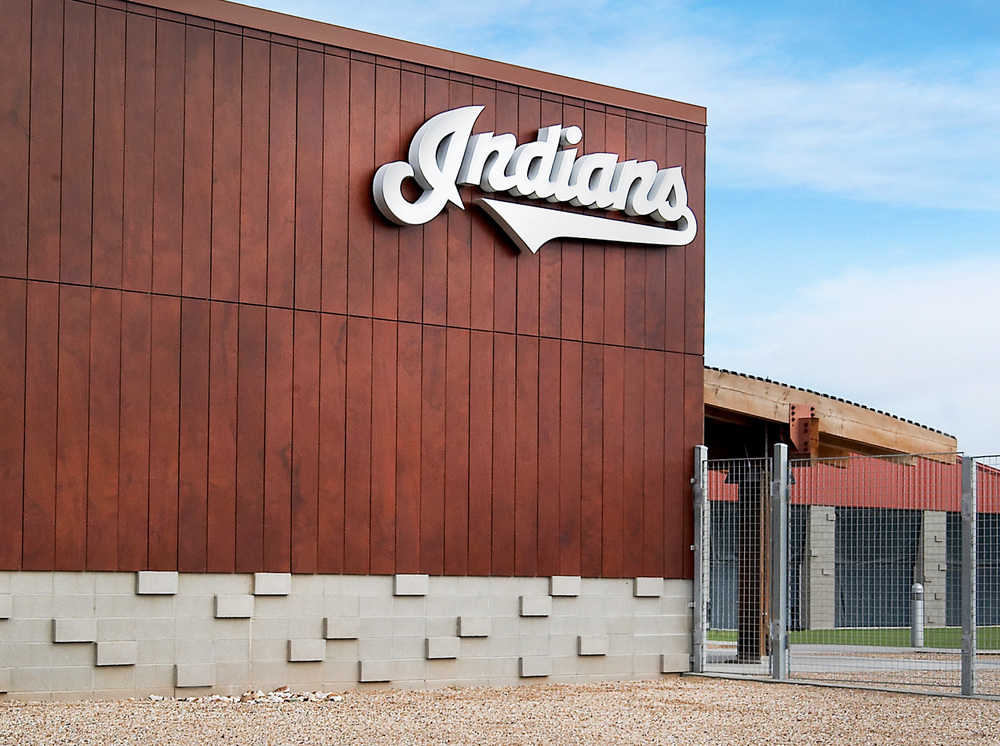 The Indians brand is mounted to a synthetic wood veneer panel system on the exterior of the club's development complex.