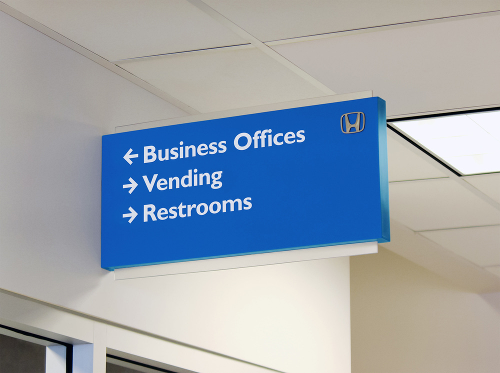 A blade sign directs Honda customers to various dealership destinations.