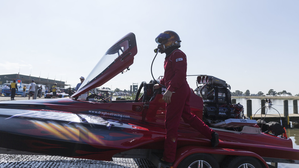 Drag Boats: Carrum: National Water Sports Centre; Craig Watson climbs aboard his boat, Thunder Down Under