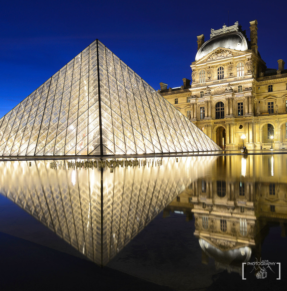 Visiting the Louvre Museum is a requirement in Paris, but going at night gives better photos