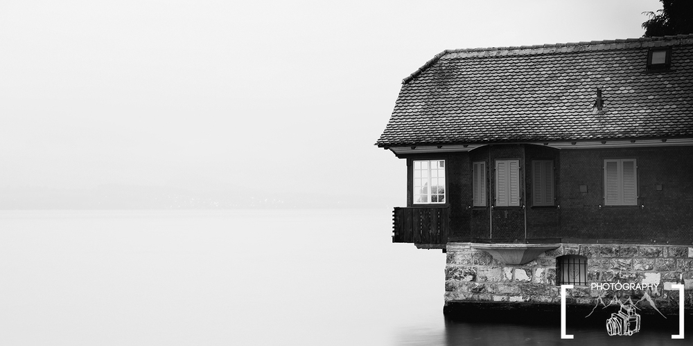 Black and White Boathouse, Switzerland. Photo Credit: Jared Lawson Photography