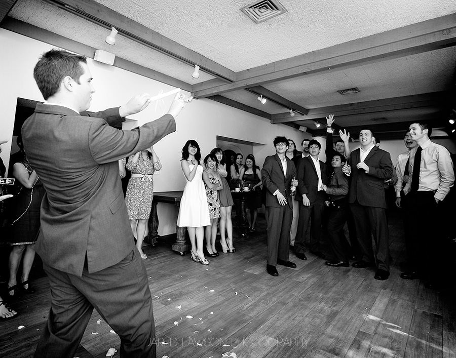 Wedding Pictures Groom Garter Toss