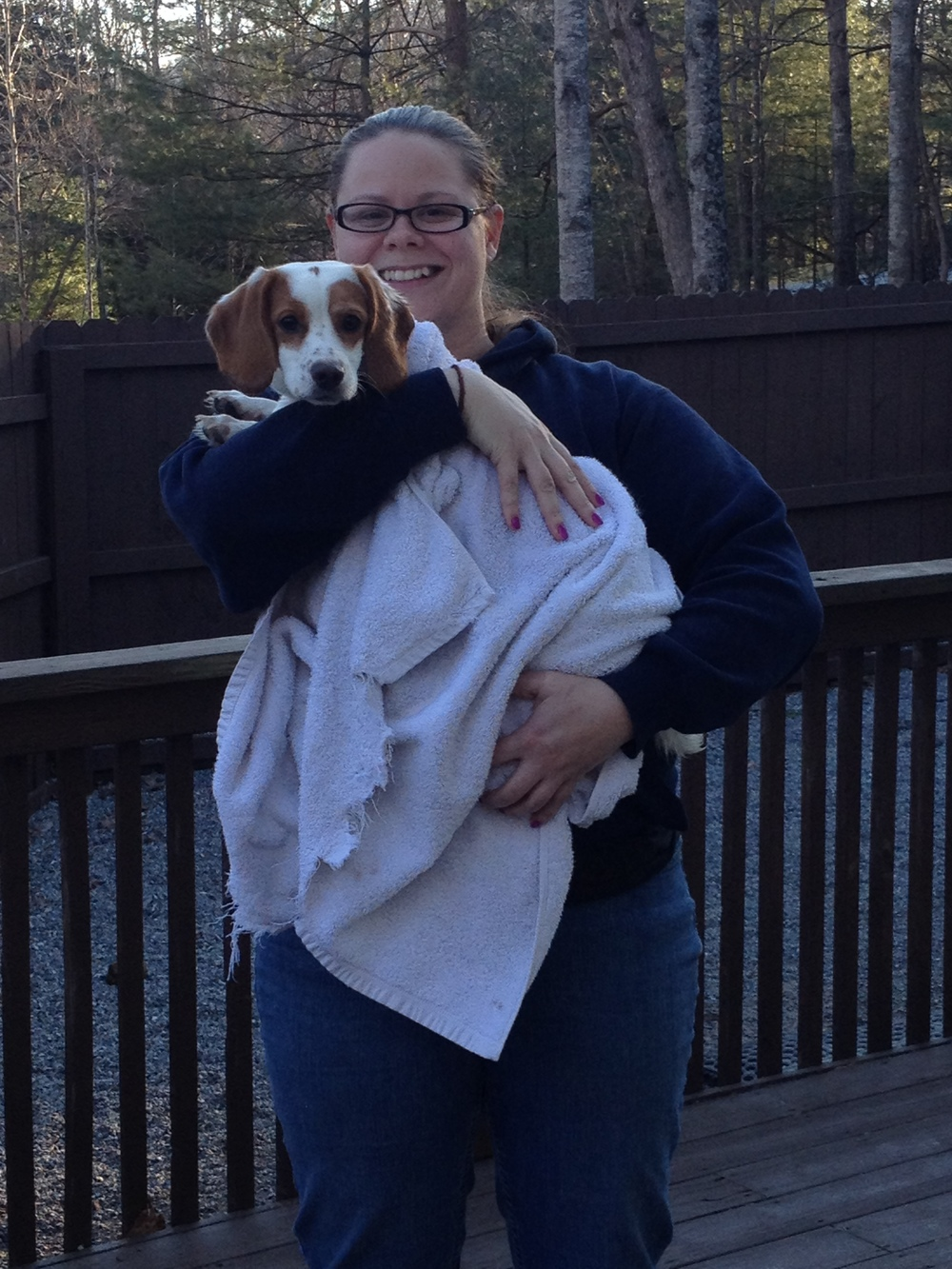"Elisha (Staff) holding ""Harper"" on the back deck after a nice warm bath."