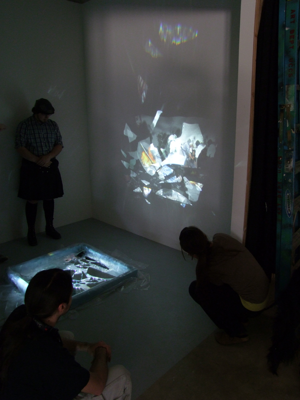 "The ""Boundaries"" Installation uses fragments of mirror, water, two-by-fours, a projector, and a composite of images from protests after the 2009 presidential election in Iran, 2011."