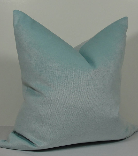 Spa blue velvet cushion on Etsy, starting from £27.41