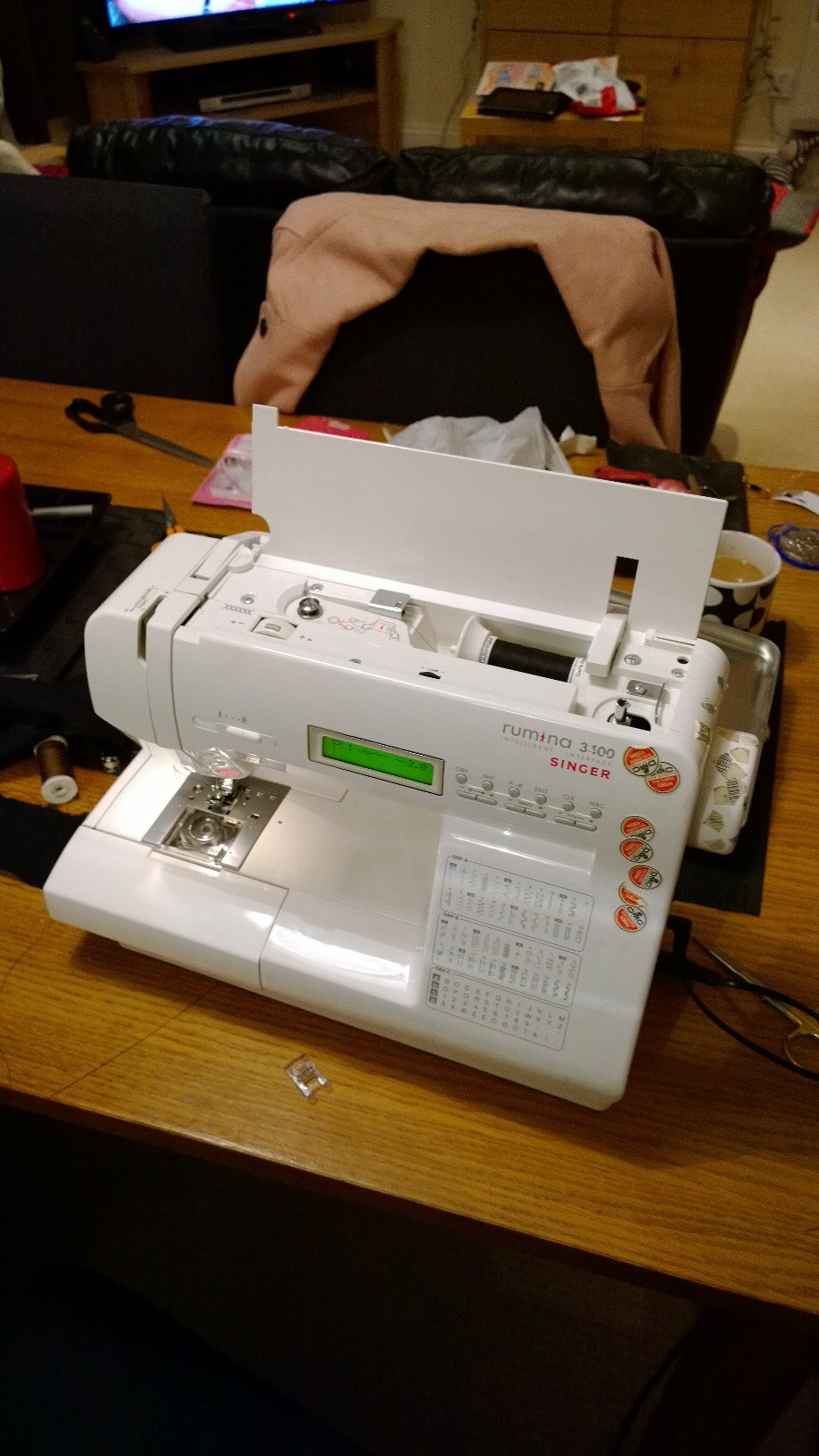 I'm introduced to the sewing machine, There are feet, bobbins, needles, things that need to go clockwise, straight stitch, zig zag stitch.... argh! This one is super high tech and cost about 500 quid. It's gotta be good for that price right? It has electronic buttons and stuff like that which makes me think it's awesome.