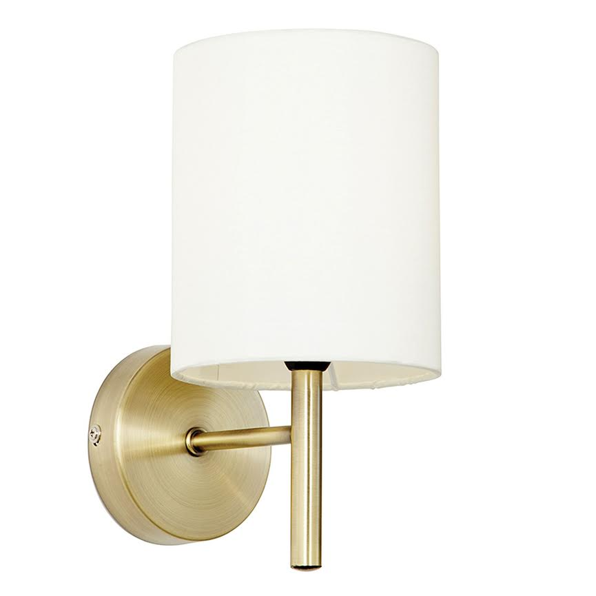 brass and cream wall light