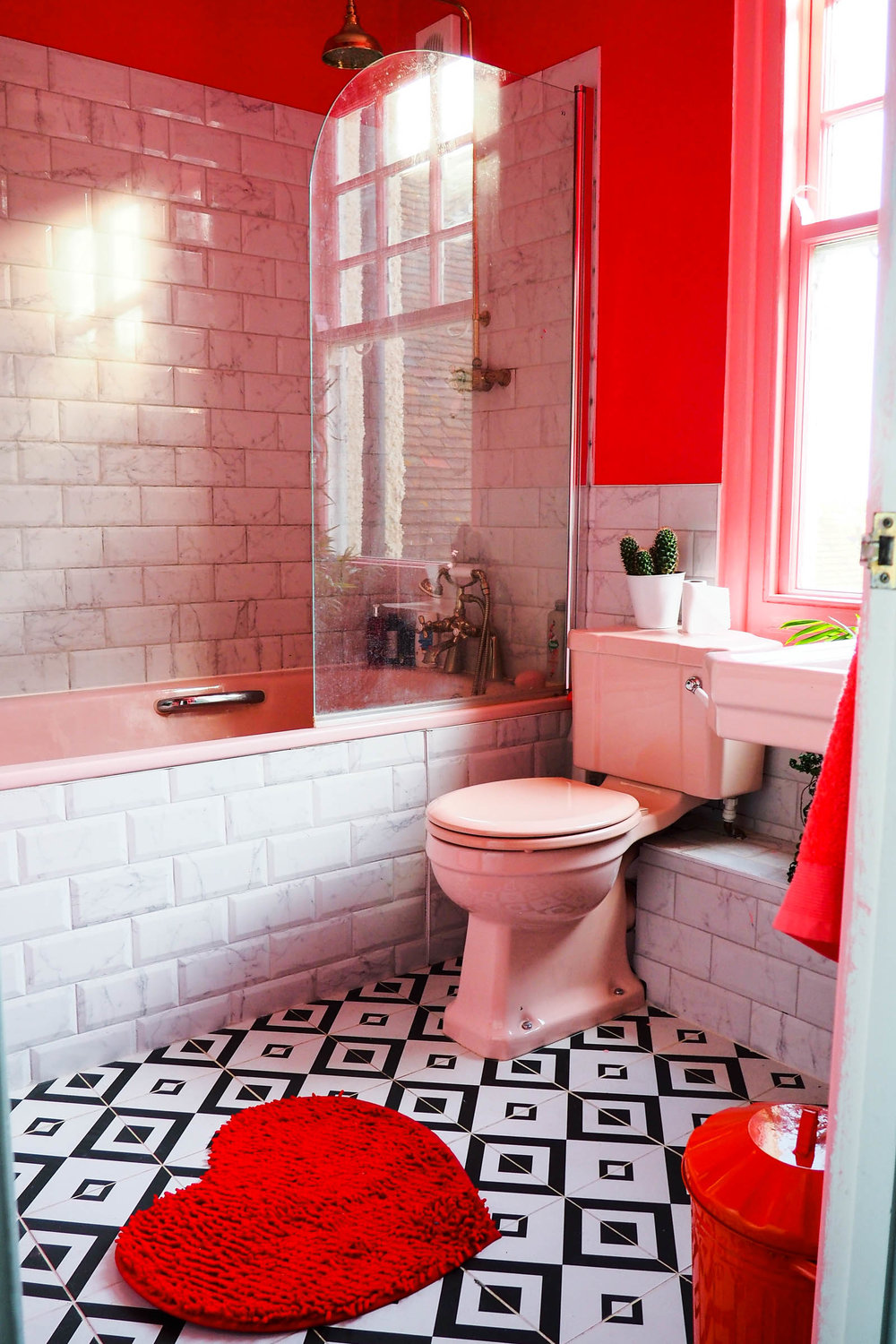 Black white and pink bathroom - Amy S Pink And Marble Bathroom With Black And White Tiles Green Houseplants And Brass Accents