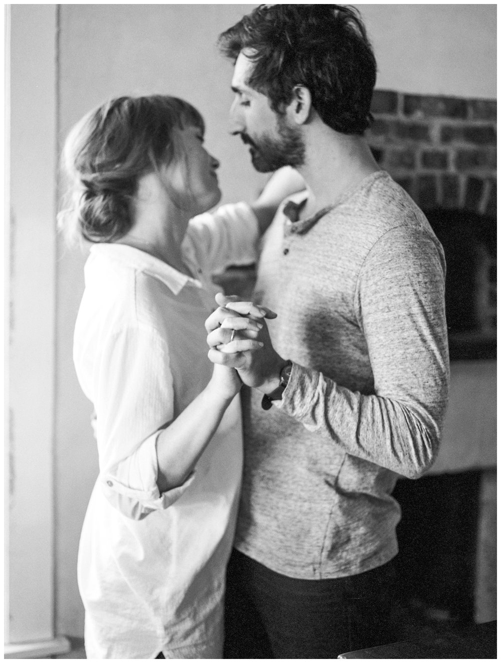 culinary anniversary session in the kitchen with a couple dancing together by fine art photographer Lissa Ryan Photography