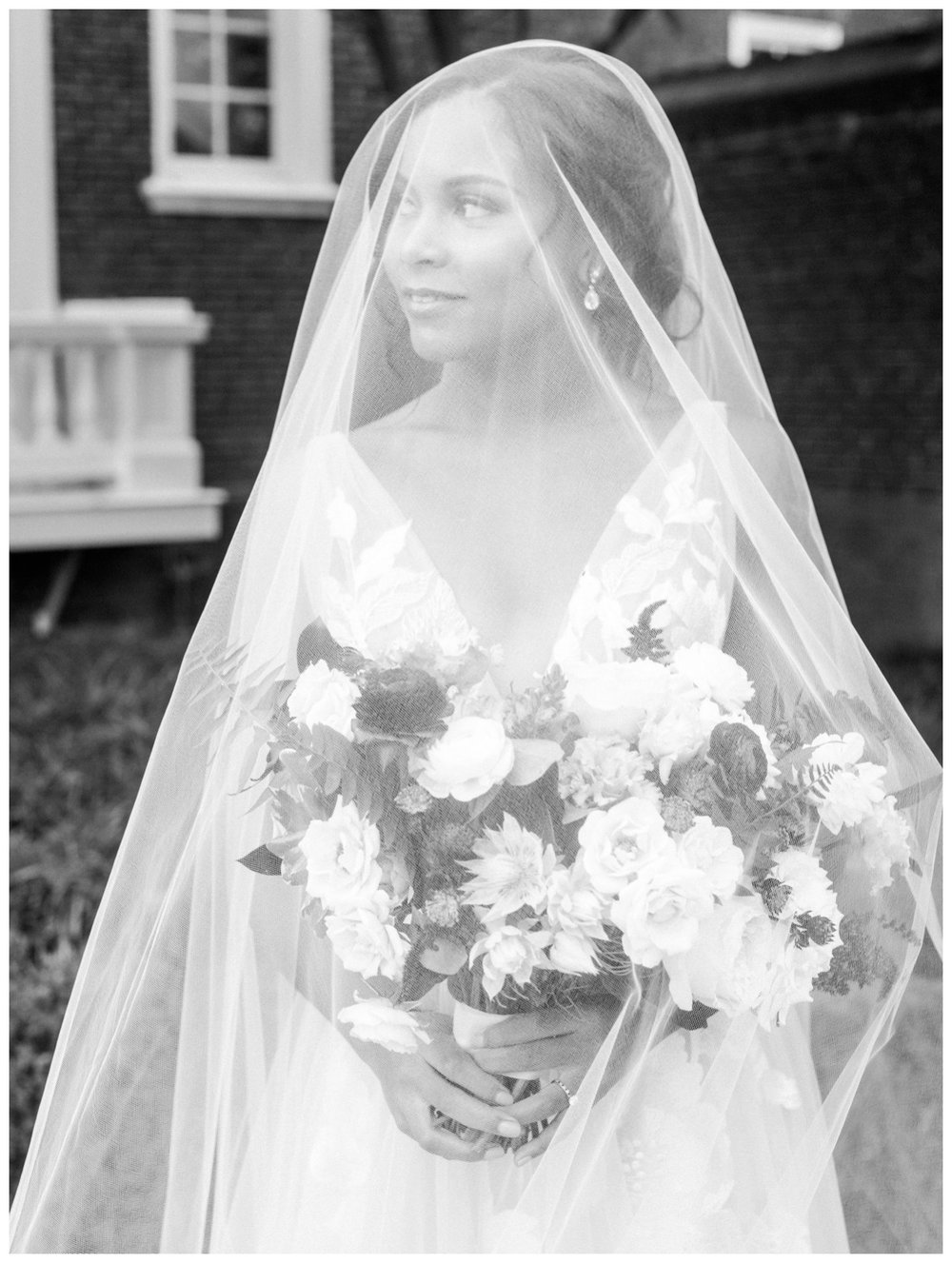 Sun drenched fall wedding in shades of pink at Oxon Hill Manor in Maryland black and white bridal portrait with veil by fine art wedding photographer Lissa Ryan Photography