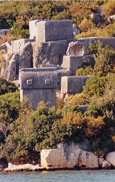 Lycian tombs along the shoreline.