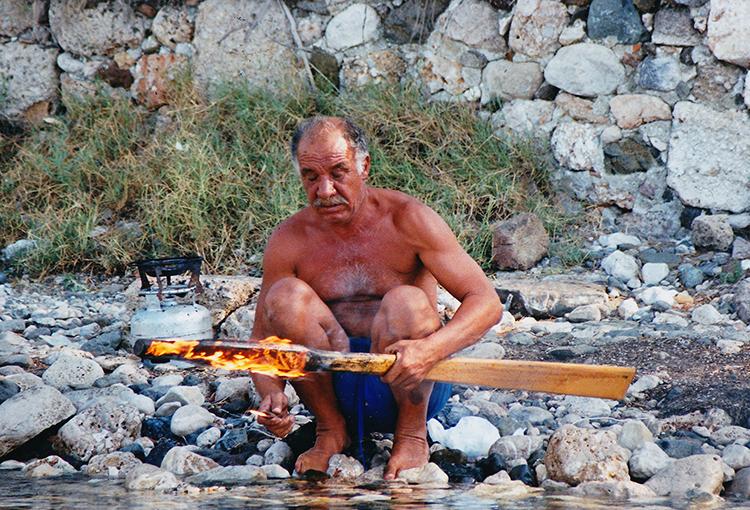 Shaping an oar with fire.