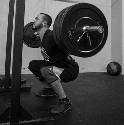 Mike competing in a 3 rep maxback squat at his first competition.