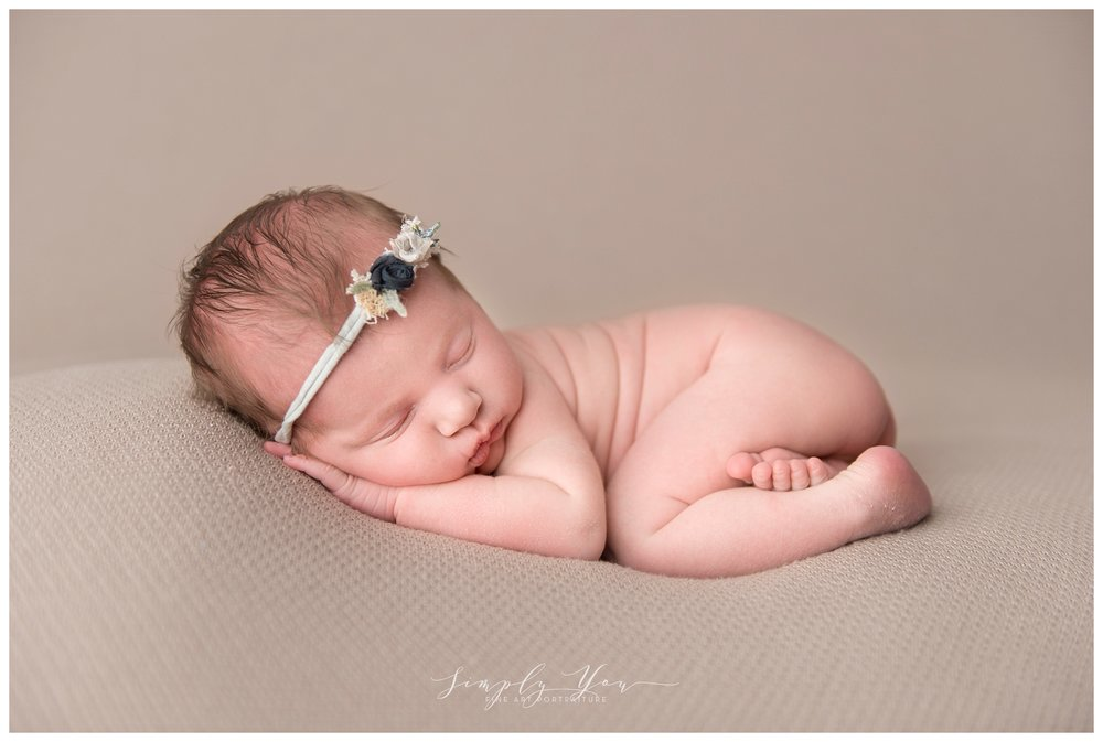 newborn baby bum up pose