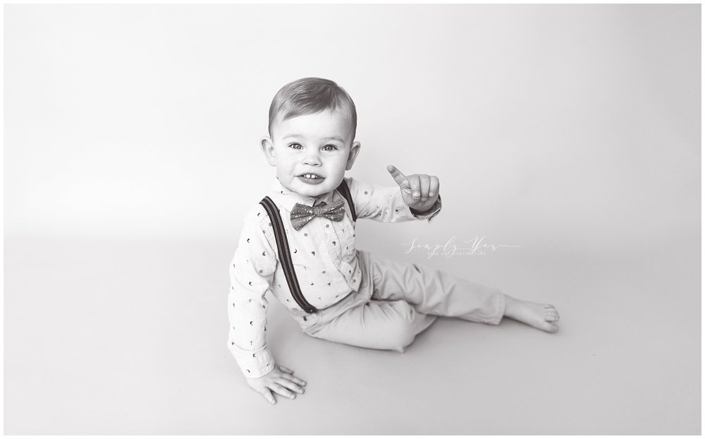 2 year old little boy in suspenders bowtie