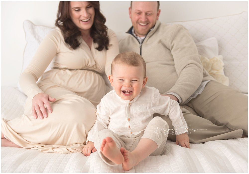 family photo white studio white bed
