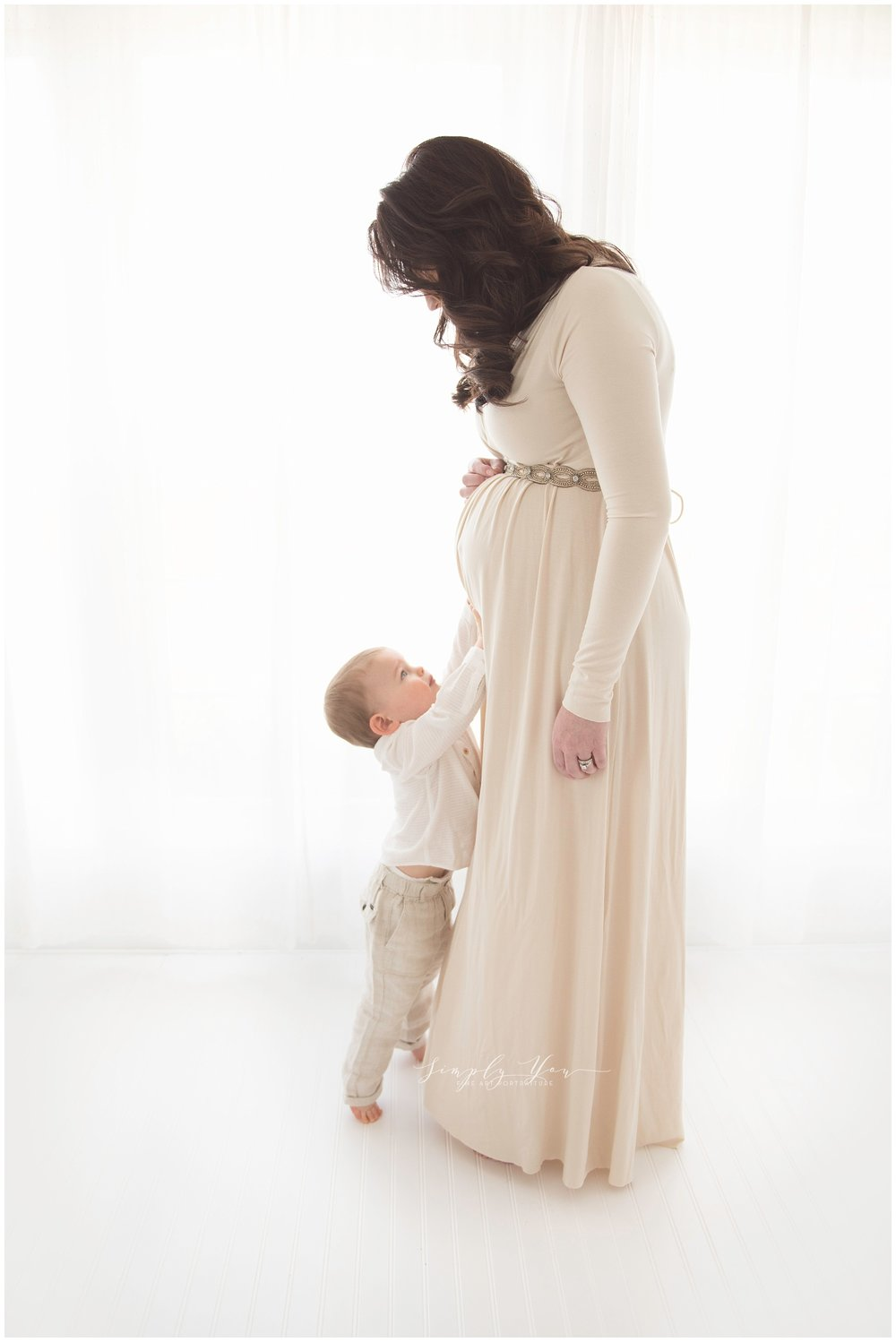 mother and son maternity photo white studio