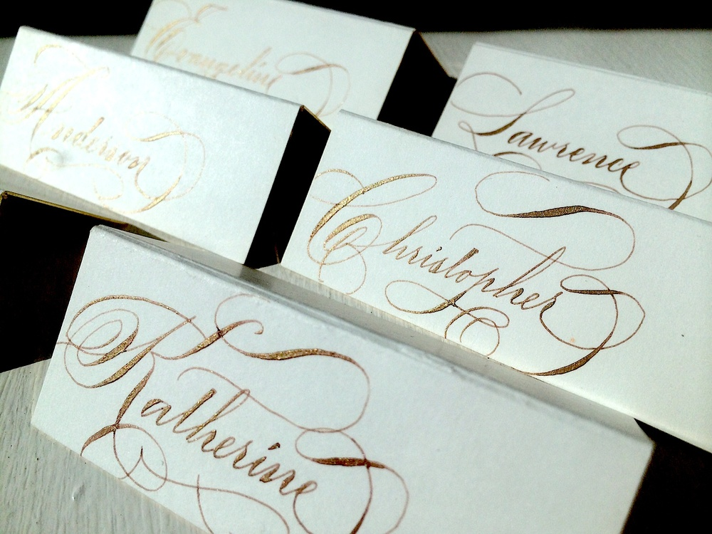 Escort cards gold ink.jpg