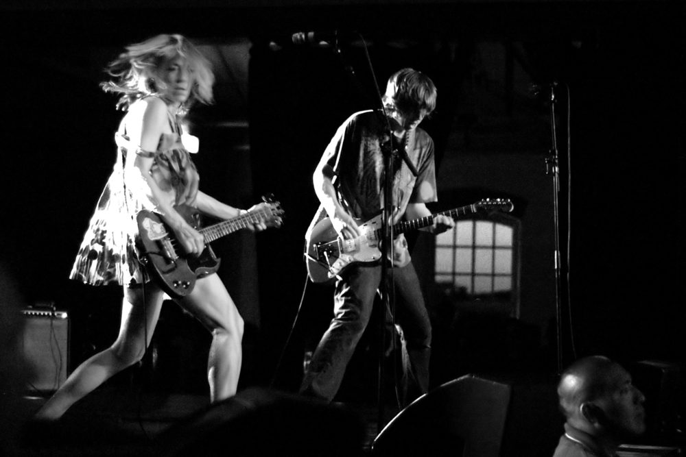 Kim Gordon and Thurston Moore of Sonic Youth doing their thing.