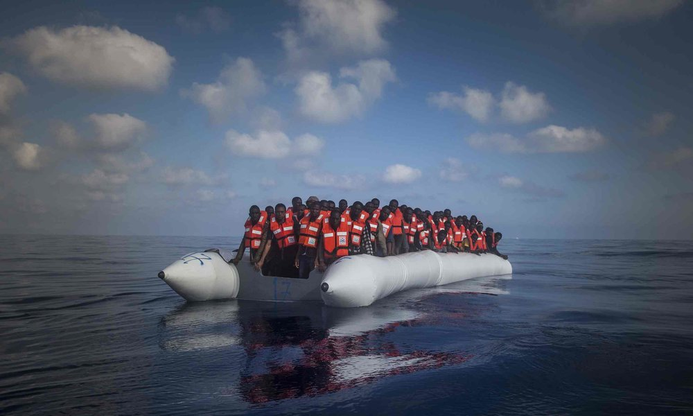 150 refugees and migrants wait for help during a rescue operation on the Mediterranean Sea off Libya. Photograph: Santi Palacios/AP