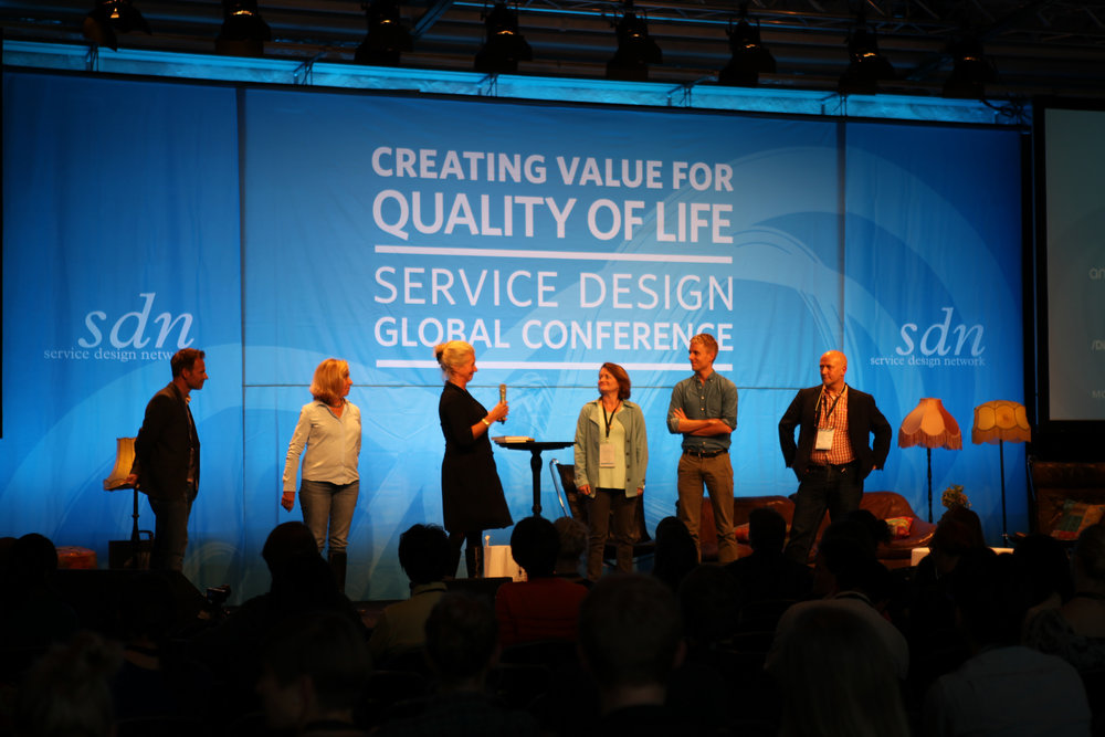 Evenson and Mager stand with other conference organizers at the SDN Global Conference in 2014 in Stockholm.