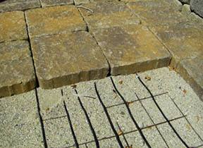 Paver bricks laid over heating element