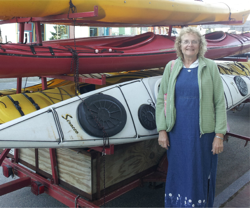 Ann posing with some kayaks in Eastport, Maine