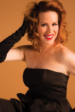 Molly Ringwald, looking glamorous next to the Steinway..