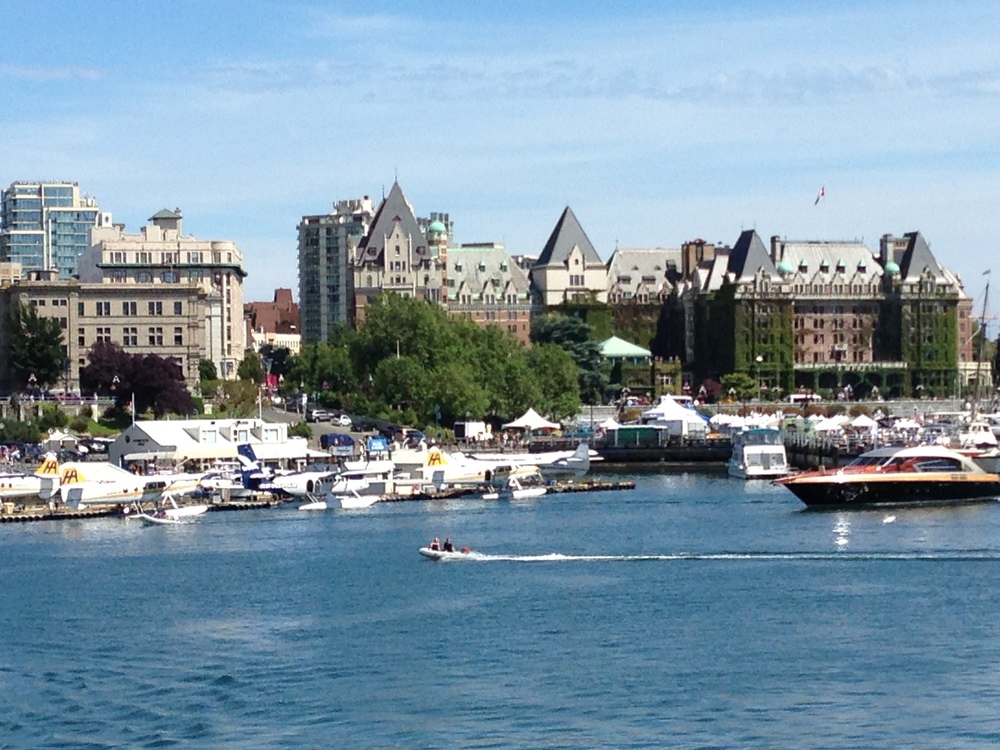 If selected, you come by passenger ferry or seaplane from Seattle!  We pick you up and take you to your hotel suite (with spa bath and fancy kitchen) -- just a few steps from the Inner Harbour -- pictured above-- abuzz with activities and sightseeing!