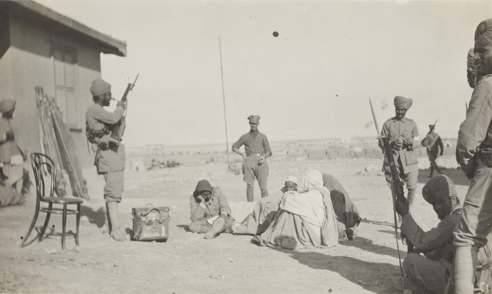 Wounded Senoussi awaiting treatment at the Jupoh Frontier.