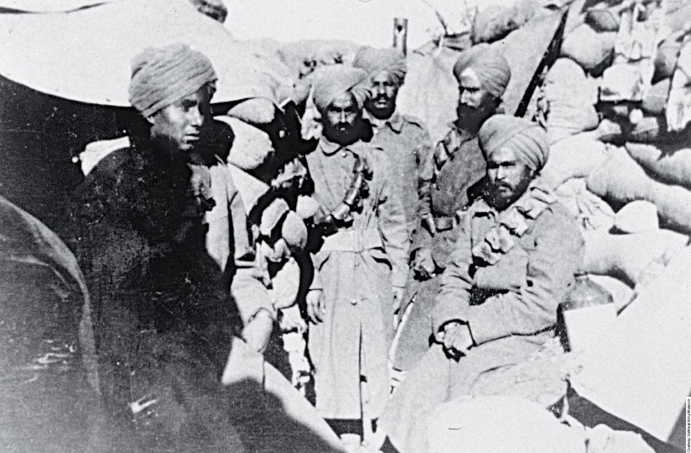 This group from the 14th Sikhs pose with a quiet determined look, all bearded save the young man on the left, probably still in his teens. Behind the men can be seen the periscope that was used to view 'no man's land' where many of their fellow soldiers were to lose their lives.
