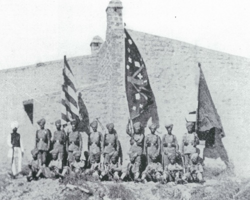 Survivors of the Gulistan sortie party pose with the captured Afridi standards for a photograph by Lt. Col. Haughton. They greeted the relief force by parading these trophies at the gate.